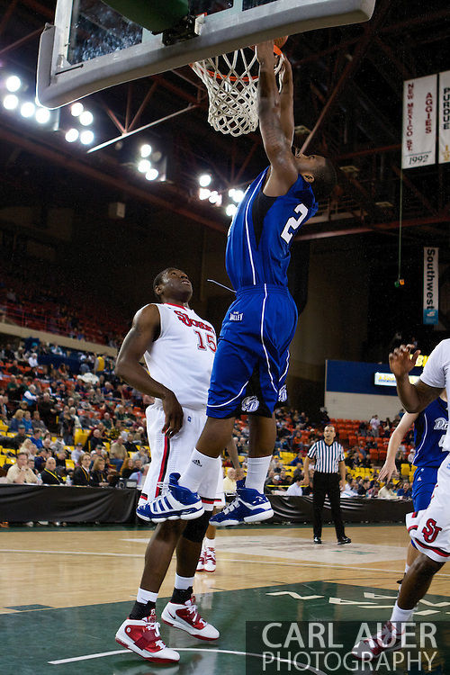 November 26th, 2010:  Anchorage, Alaska - Drake Bulldog freshman guard Rayvonte Rice (24) misses a dunk attempt in the Bulldog's loss to St. Johns at the Great Alaska Shootout.  The Red Storm defense held Drake to a tournament low score as St. Johns advanced to the final game 82-39.