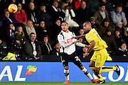 Derby County defender Max Lowe (25) battles with Burton Albion forward, on loan from Brighton, Chris O'Grady (8) during the EFL Sky Bet Championship match between Derby County and Burton Albion at the Pride Park, Derby, England on 21 February 2017. Photo by Jon Hobley.