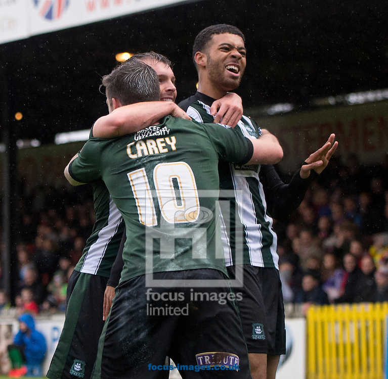 Jake Jervis of Plymouth Argyle (right) celebrates with team-mates after scoring his team's first goal to ale it 1-0 during the Sky Bet League 2 match at Bootham Crescent, York<br /> Picture by Russell Hart/Focus Images Ltd 07791 688 420<br /> 14/11/2015