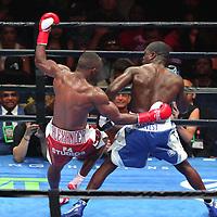 Andre Berto trips Devon Alexander during a Premier Boxing Champions fight on Saturday, August 4, 2018 at the Nassau Veterans Memorial Coliseum in Uniondale, New York.  (Alex Menendez via AP)