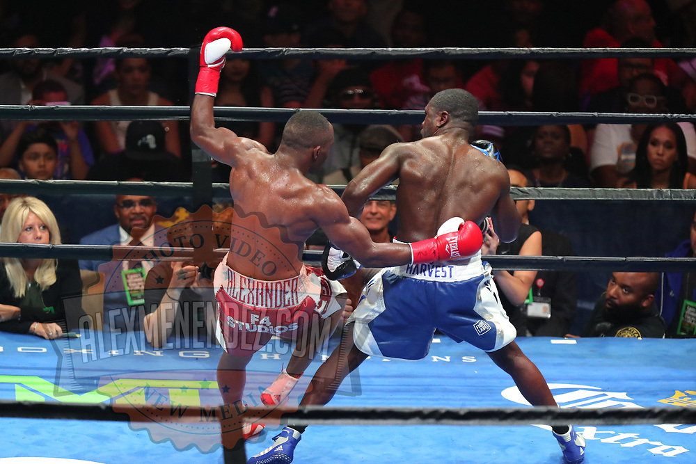Andre Berto trips Devon Alexander during a Premier Boxing Champions fight on Saturday, August 4, 2018 at the Nassau Veterans Memorial Coliseum in Uniondale, New York.  (Alex Menendez via AP)