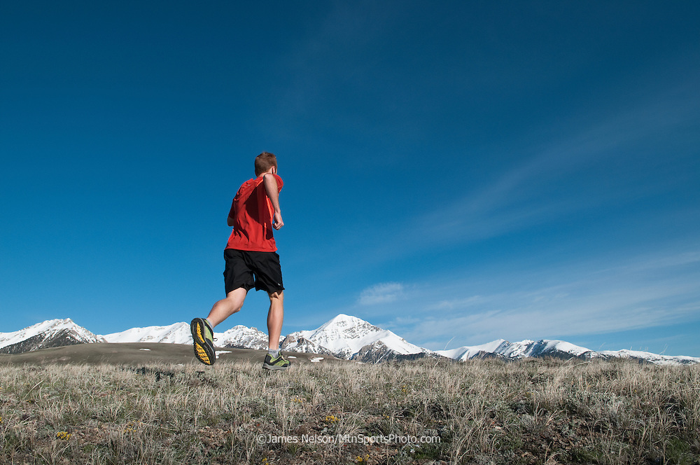 Trail runner Evan Honeyfield logs a few miles during a workout on a spring morning in Idaho's Lemhi Range.