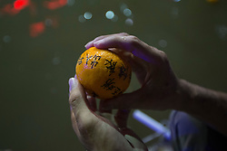 © Licensed to London News Pictures. 21/02/2016 Ipoh, Malaysia. People scoop out oranges from the water, thrown in by unmarried men and women seeking love. The oranges have contact information written on them, at Kwan Yin Tong Temple in Ipoh, Malaysia, during the Chap Goh Meh celebration, the fifteenth night of Chinese New Year also known as 'Chinese Valentine's Day', Sunday, Feb. 21, 2016. Photo credit : Sang Tan/LNP