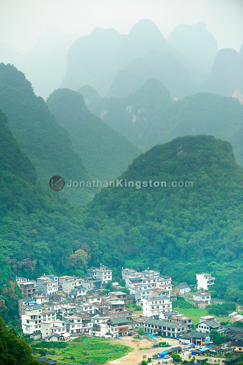 High angle view of a small village nestled among Karst formations near Yangshuo, China.