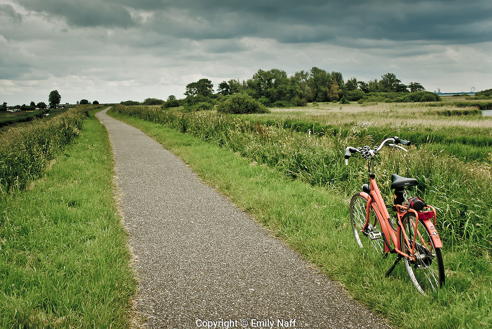 Bike trails take travelers through the beautiful countryside outside of Amsterdam.