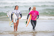 Francisca Veselko (PRT) and Eveline Hooft (NLD) exit the water after their Round 2 heat during the 2019 Boardmasters Roxy Pro Surf Competition, WSL Qualifier at Fistral Beach, Newquay, Cornwall on 8 August 2019.