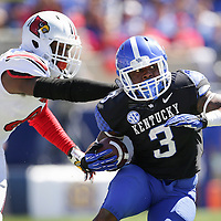UK defensive back Fred Tiller cut in front of U of L safety Gerod Holliman in the third quarter as the University of Kentucky plays the University of Louisville at Commonwealth Stadium in Lexington, Ky. Saturday Sept. 14, 2013. Louisville beat Kentucky 27-13. Photo by David Stephenson