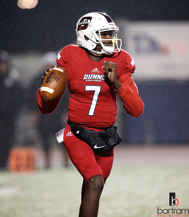 Bishop Dunne quarterback Stacy Conner looks for a receiver as rain falls during the TAPPS Division I state championship game on Saturday, Dec. 3, 2016 at Panther Stadium in Hewitt, Texas. Bishop Lynch High School won 21-17. (Photo by Kevin Bartram)