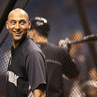 New York Yankees shortstop Derek Jeter (2) is seen warming up on the field prior to a major league baseball game between the New York Yankees and the Tampa Bay Rays at Tropicana Field on Thursday, Sept. 17, 2014 in St. Petersburg, Florida. (AP Photo/Alex Menendez)