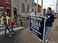 PHILADELPHIA - NOVEMBER 4: Jason Derker (L), of Stamford, Ct. and Geoff Schneider (R), of Wilton, Ct. hold a sign supporting Obama as local children pass by on Election Day November 4, 2008 in Philadelphia, Pennsylvania. Hundreds of Temple University students waited more then two hours to cast their vote in what is expected to be a record turnout at the polls. (Photo by William Thomas Cain/Getty Images)