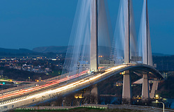 View of new Queensferry Crossing bridge at night spanning the Firth of Forth between West Lothian and Fife in Scotland, United Kingdom.