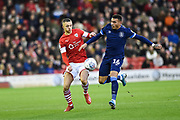 Jordan Williams of Barnsley FC and Karlan Grant of Huddersfield Town compete for the ball during the EFL Sky Bet Championship match between Barnsley and Huddersfield Town at Oakwell, Barnsley, England on 11 January 2020.