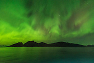 Orion rising amid patchy aurora from the Norwegian coast on October 24, 2017, from the deck of the m/s Nordlys, a Hurtigruten ferry ship. <br /> <br /> This is a single 1-second exposure with the Sigma 14mm f/1.8 Art lens and Nikon D750 at ISO 6400.