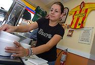 ORLANDO. (FL, EEUU), 23/03/06.- La colombiana Patricia Parra, del Restaurante ?La Abundancia? prepara los almuerzos del medio día para sus clientes en la ciudad de Orlando Florida, hoy, 23 de Marzo de 2006. Parra manifestó que la comida y los antojitos latinos son el éxito de este negocio hispano. El espíritu emprendedor, la diversidad étnica y las oportunidades para crear nuevos negocios se han convertido en el principal impulso del sector empresarial hispano del centro de Florida que crece de forma vertiginosa...(Photo: GerardoMora/Independent Photo Agency)..