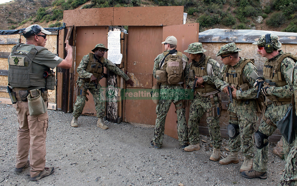 AZUSA, Calif. (May 21, 2017) Sailors assigned to Fleet Combat Camera Pacific (FCCP) prepare to enter a mock compound during close quarters battle training at FCCP's Summer Quick Shot Exercise 2017 in Azusa, Calif. Quick Shot is a biannual exercise that provides live-fire and scenario based training to combined joint combat camera assets. (U.S. Navy Combat Camera photo by Mass Communication Specialist 2nd Class Antonio Turretto Ramos/Released)170521-N-DC018-020<br />