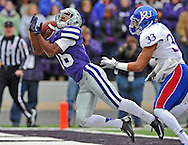 Sports Illustrated -- Wide receiver Tyler Lockett #16 of the Kansas State Wildcats catches a 34-yard touchdown pass against defensive back Tyler Patmon #33 of the Kansas Jayhawks during the second quarter at Bill Snyder Family Stadium in Manhattan, Kansas.