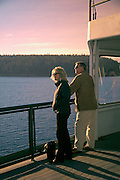 Image of a couple on a ferry in the San Juan Islands, Washington, Pacific Northwest, model released