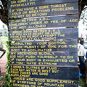 A caution sign at Londorossi Gate, one of the National Park ranger gates to Kilimanjaro National Park, and the gate one must check in to when climbing the Lemosho Route of Mount Kilimanjaro.