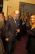 Prince Michael of Kent and Basia Briggs, Reception to support the Hyde Park Appeal for Liberty Drives ( a charity which enables people to travel around Hyde Park in electric buggies) in the presence of Prince Michael of Kent. Officers Mess. Household Cavalry Mounted Regiment. Hyde Park Barracks. 30 November 2004. ONE TIME USE ONLY - DO NOT ARCHIVE  © Copyright Photograph by Dafydd Jones 66 Stockwell Park Rd. London SW9 0DA Tel 020 7733 0108 www.dafjones.com