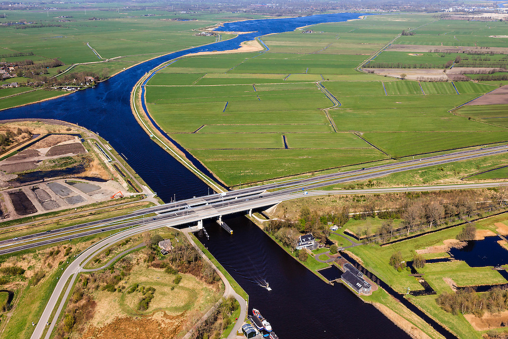 Nederland, Friesland, Waldwei, 01-05-2013; Fonejachtbrug in A31 over Prinses Margrietkanaal in de N31. Het kanaal is onderdeel van de hoofdvaarroute van Amsterdam via Lemmer naar Delfzijl.<br /> Bridge on the Prinses Margrietkanaal, Friesland near Leeuwarden, North Netherlands. The channel is part of the main shipping route to Amsterdam. Leeuwarden on the horizon. <br /> luchtfoto (toeslag op standard tarieven);<br /> aerial photo (additional fee required);<br /> copyright foto/photo Siebe Swart