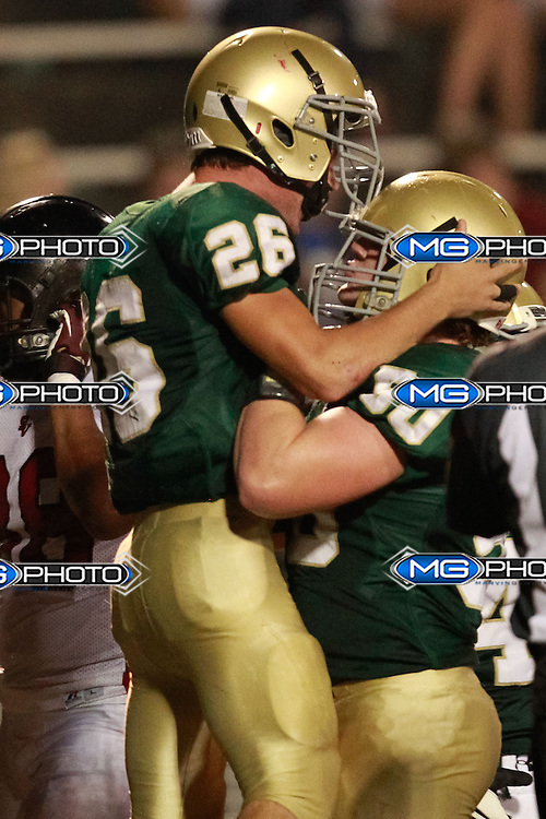 Sep 6, 2013; Mountain Brook, AL, USA;  Mountain Brook's Gene Bromberg (26) celebrates with Mountain Brook's Reed Adams (50) after scoring a touchdown against Shades Valley. Mandatory Credit: Marvin Gentry