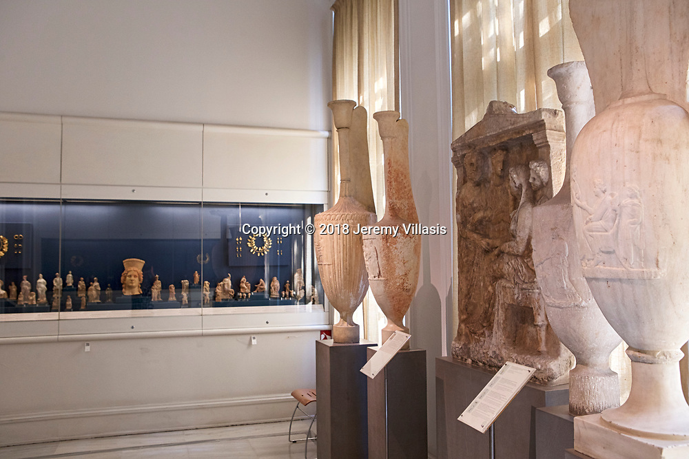 Gallery 6 of the Benaki Museum featuring art from prehistory to the late Roman period including a marble grave stele from Keratea, Attica (mid-4th century BC), surrounded by four Attic marble funerary lekythos. All feature a scene of dexiosis (farewell).