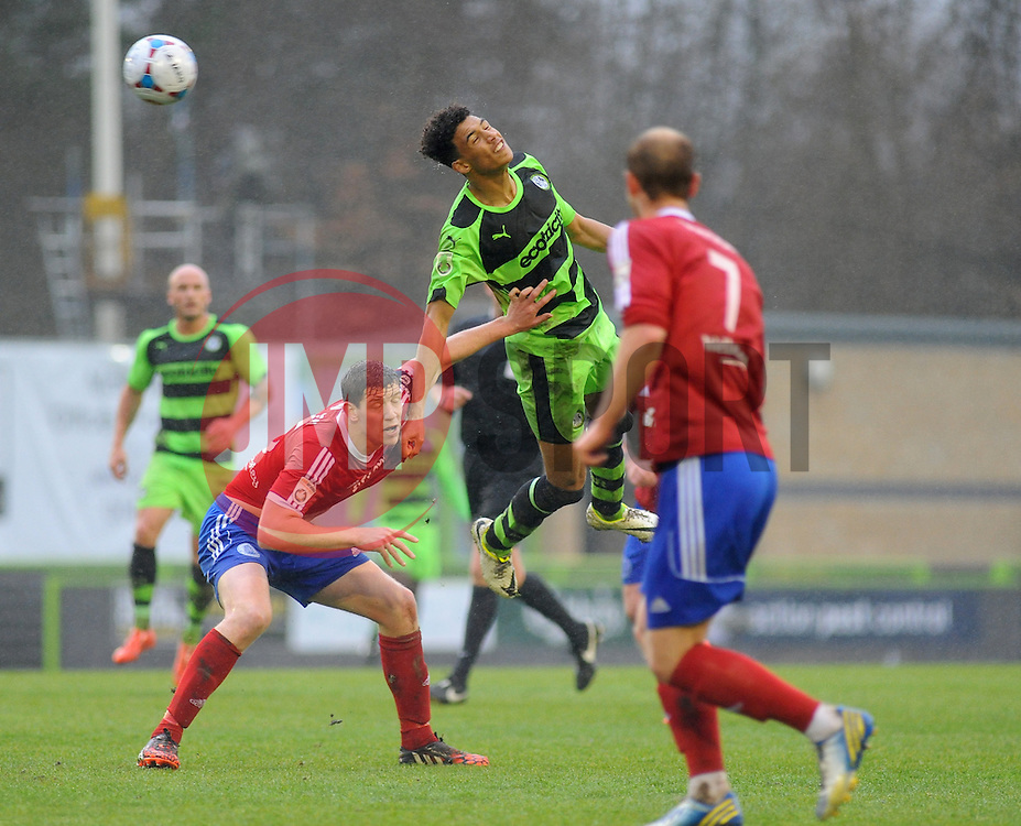 Forest Green Rovers's Kurtis Guthrie wins the high ball against Aldershot Town's Sam Hatton - Photo mandatory by-line: Nizaam Jones - Mobile: 07966 386802 - 03/04/2015 - SPORT - Football - Nailsworth - The New Lawn - Forest Green Rovers v Aldershot Town - Vanarama Football Conference