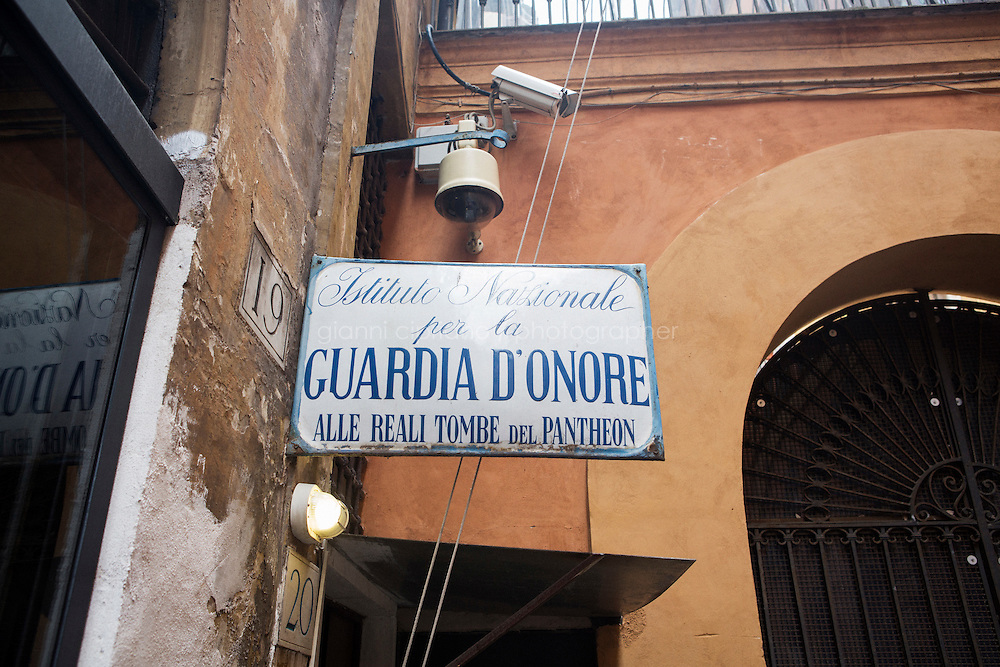 ROME, ITALY - 29 JULY 2014: The entrance sign of the National Institute for the Honor Guards to the royal tombs of the Pantheon, is here at its headquarters in Rome, Italy, on July 29th 2014.<br /> <br /> The National Institute for the Honor Guards to the royal tombs of the Pantheon is a monarchic-oriented whose goal is to watch over the royal tombs at the Pantheon. Italy&rsquo;s first king, Vittorio Emanuele II and his son Umberto I, as well as Umberto's wife Queen Margherita are entombed in the Pantheon.