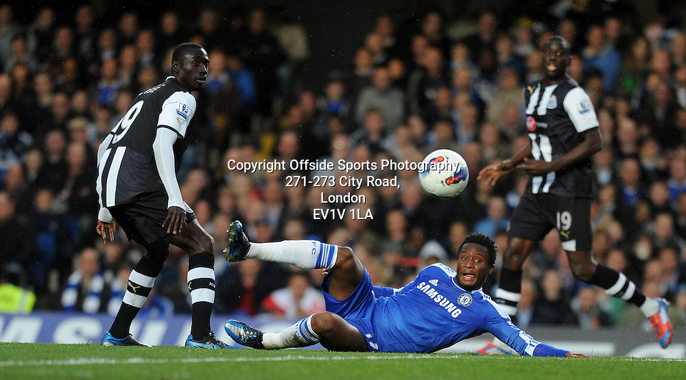02/05/2012 - Barclays Premier League Football - 2011-2012 - Chelsea v Newcastle United - Chelsea's John Obi Mikel beats Newcastle's Papiss Cisse to the ball. - Photo: Charlie Crowhurst / Offside.