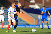 David Perkins competes for the ball during the EFL Sky Bet League 1 match between Rochdale and Portsmouth at Spotland, Rochdale, England on 29 September 2018.