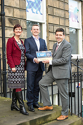 Pictured: Laura Peacock, Investors in Young People, hands over the gold award to John Moran, managing director Grant Properties and Jamie Helpburn<br />
