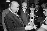 Alfred Hitchcock and the Head of Police (Prefet) examining a piece from the Crime museum,which are parts of famous crimes committed in France. <br /> This one is a small guillotine.<br /> <br /> Alfred Hitchcock et le prefet de Police examine une pi&egrave;ce du mus&eacute;e de la criminalit&eacute;, qui font partis d'une collection sur les  crimes les plus c&eacute;l&egrave;bres commis en France .<br /> Celui-ci est une petite guillotine.
