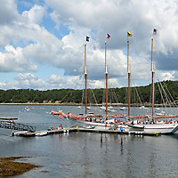 The four masted sightseeing sailing vessel the Margaret Todd ready to unload tourists at its dock. Bar Harbor, Mount Desert Island, Maine, USA