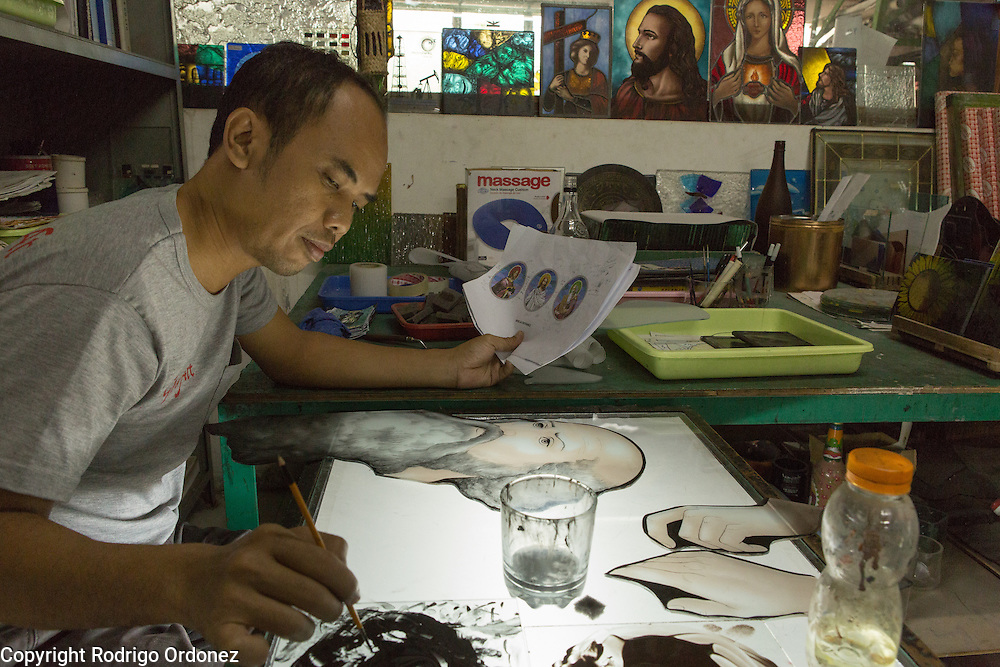 An employee draws details on a piece of stained glass using ink in the design studio of the Eztu Glass factory in Tangerang, near Jakarta, Indonesia, on July 2, 2015. Indonesia is the country with the world's largest Muslim population, of about 205 million people. Roughly 88% of Indonesia's population is Muslim, and the nation is home to about 13% of the world's Muslims.