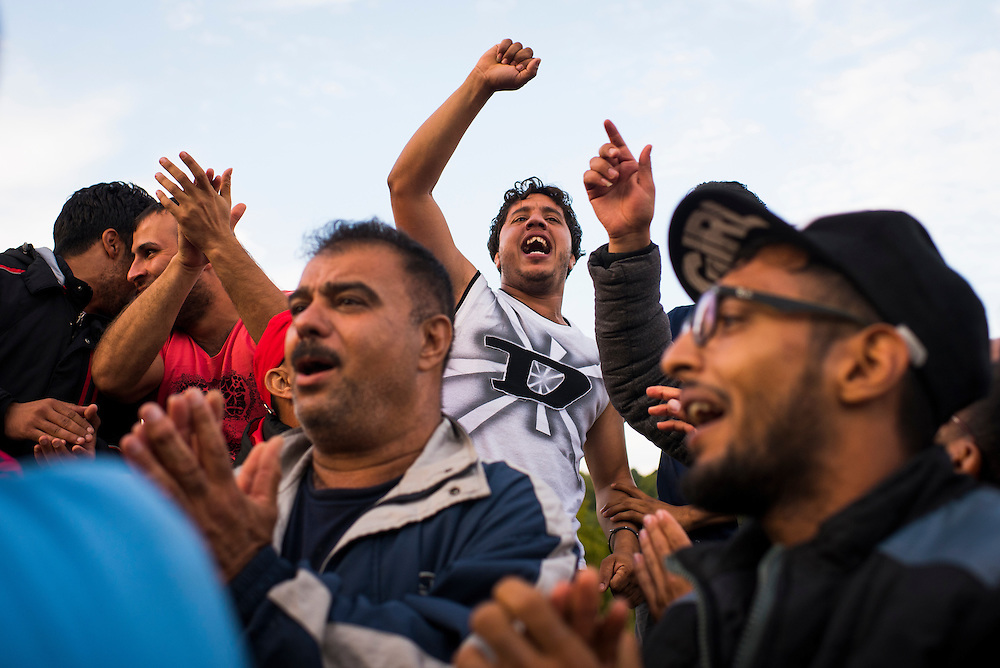 Frustrated migrants implore authorities to open the border to Slovenia on September 19, 2015 in Harmica, Croatia. After Hungary sealed its Serbian border, many migrants sought a new route to Western Europe through Croatia. In Harmica, Slovenian police installed barriers and formed a skirmish line, intermittenly allowing migrants to cross into Rigonce.
