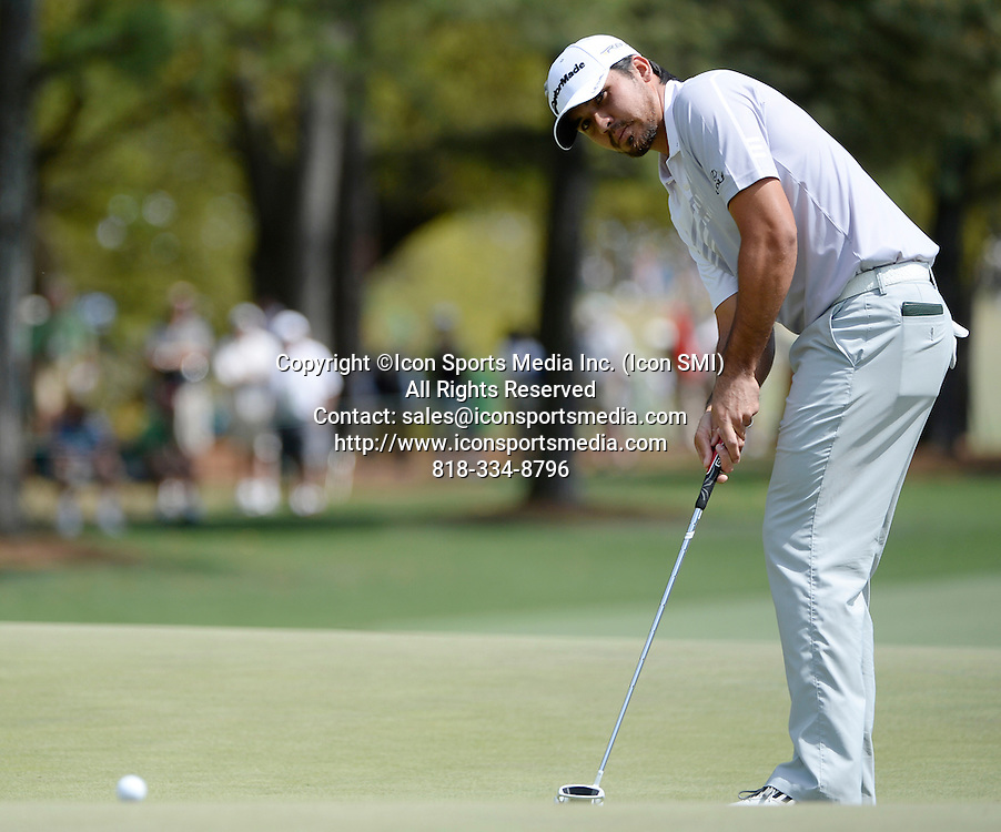 April 13, 2013 - Augusta, Georgia, U.S. - Jason Day putts on No. 1 during the third round of the 2013 Masters Tournament at Augusta National Golf Club on Saturday, April 13, 2013, in Augusta, Ga.