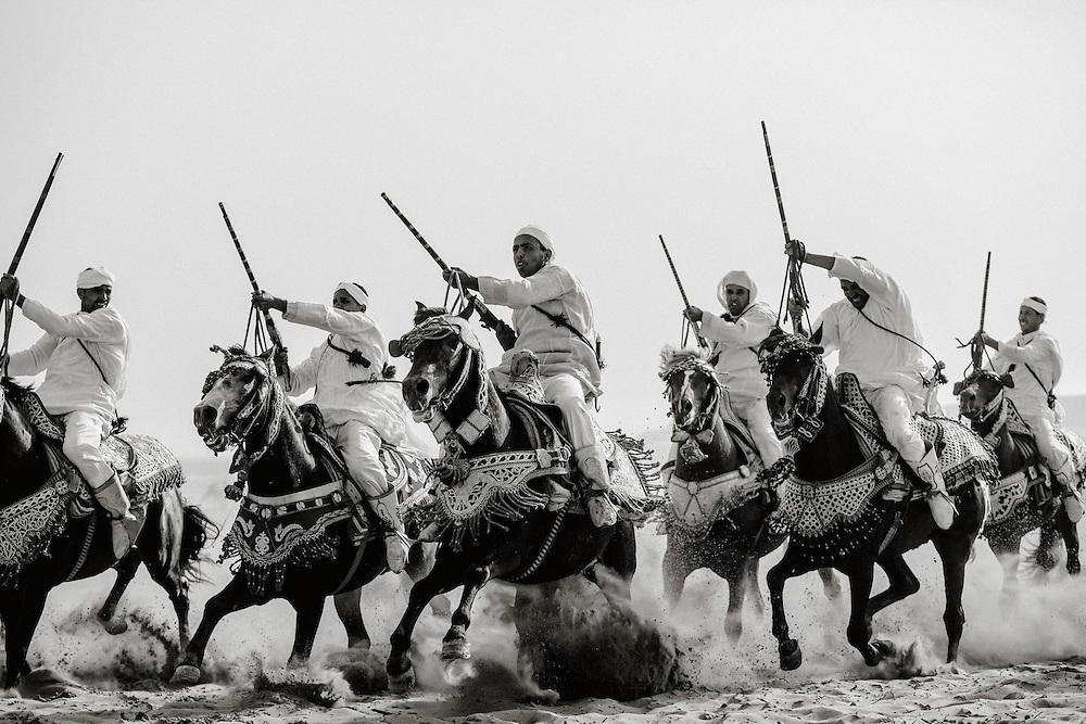 Fantasia Riders on the beach in Essaouira, Morocco.
