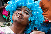 A man is wearing a blue wig while celebrating Khmer New Year in Chork Village, TboungKhmum Province, Cambodia.