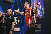 Mensur Suljovic celebrates winning a leg during the William Hill World Darts Championship at Alexandra Palace, London, United Kingdom on 27 December 2016. Photo by Shane Healey.