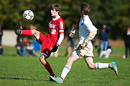 CVU's Cooper O'Connell (10) kicks the ball during the boys soccer game between the Champlain Valley Union Redhawks and the Essex Hornets at Essex High School on Saturday mooring October 10, 2015 in Essex. (BRIAN JENKINS/For the FREE PRESS)