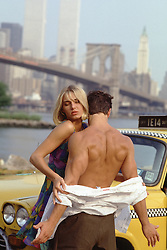 hot couple in New York City overlooking The World Trade Center in New York City