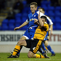 St Johnstone v Alloa..  28.12.02<br />Keigan Parker is tackled by Craig Valentine<br /><br />Pic by Graeme Hart<br />Copyright Perthshire Picture Agency<br />Tel: 01738 623350 / 07990 594431