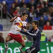 Tim Cahill, New York Red Bulls,  wins a header while challenged by Gonzalo Segares, Chicago Fire, during the New York Red Bulls V Chicago Fire, Major League Soccer regular season match at Red Bull Arena, Harrison, New Jersey. USA. 27th October 2013. Photo Tim Clayton
