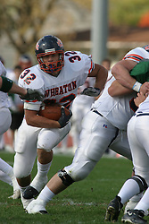 22 October 2005: Thunder RB Chaz Black sprints up field through a gap in the line. The Illinois Wesleyan Titans posted a 23 - 14 home win by squeeking past the Thunder of Wheaton College at Wilder Field (the 5th oldest collegiate field in the US) on the campus of Illinois Wesleyan University in Bloomington IL
