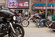 Leather clad bikers ride down Main Street during the 74th Annual Daytona Bike Week March 7, 2015 in Daytona Beach, Florida.