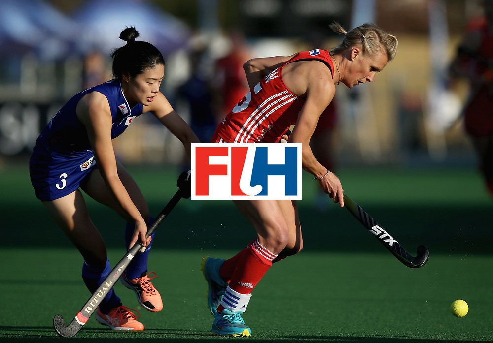 JOHANNESBURG, SOUTH AFRICA - JULY 12: Alex Danson of England and Emi Nishikori of Japan battle for possession  during day 3 of the FIH Hockey World League Semi Finals Pool A match between Japan and England at Wits University on July 12, 2017 in Johannesburg, South Africa. (Photo by Jan Kruger/Getty Images for FIH)
