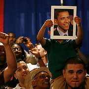 Father and son show their support of Senator Barrack Obama during a rally at the Palm Beach Community College in Lake Worth attended by 1,700 people. ....