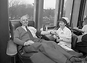 Tony Ward Gives Blood..1984.16.03.1984.03.16.1984.16th March 1984..With a possible shortage of blood over the St Patrick's Weekend,Tony Ward,Irish Rugby International,led an awareness campaign by donating blood. He attended The Blood Transfusion Service,Pelican House,Mespil Road,Dublin...Photo, it's what your left arm is for. A donor,lying back relaxed,prepares to give his donation.