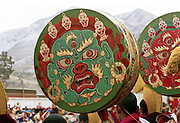 A tibetan drum painted with the face of Mahakala a protective and terrific deity of tibetan buddhism, used during the Cham Dances (dances of spirits) three days before the end of Monlam Chenmo,( the Great Prayer ). Monastery of Labrang, Xiahe, China, 03/04/2007.
