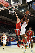 SMU Mustangs forward Feron Hunt (1) drives on Hartford Hawks forward Miroslav Stafl (12) while Moses Flowers (4) and  Ethan Chargois (25) await the rebound during an NCAA college basketball game, Wednesday, Nov. 27, 2019, in Dallas.SMU defeated Hartford 90-58. (Wayne Gooden/Image of Sport)